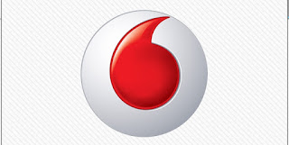 White Circle with Red Comma Logo