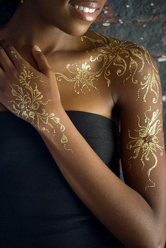 Gold Ink Tattoos On Dark Skin