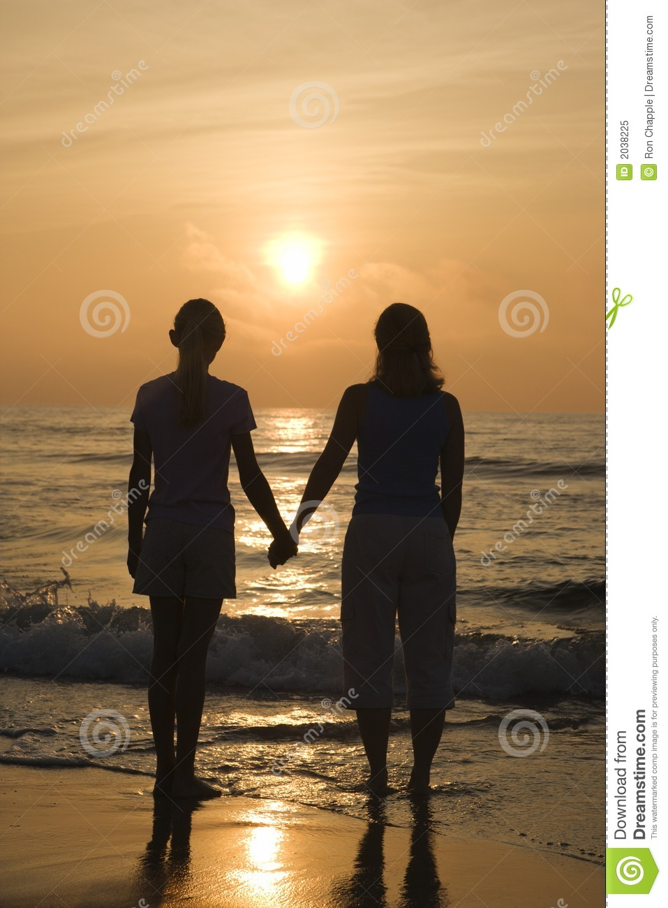 Mother and Teenage Daughter Holding Hands