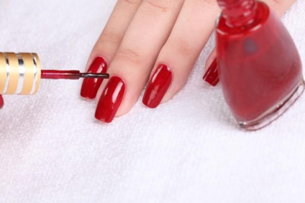 Girl Hand with Nail Polish
